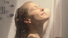 Woman washing in shower Stock Footage
