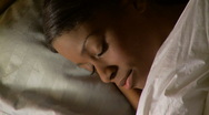 Portrait of young woman sleeping in bed Stock Footage