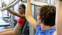 Two young women friends working out at gym Stock Footage