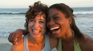 Portrait of two young women at beach during sunset Stock Footage