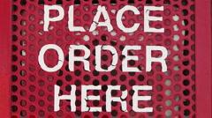 Place order here drive thru menu talk box Stock Footage