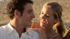 Close up of young couple singing and talking at beach - stock footage