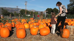 Pumpkin Patch (mother and daughter) Stock Footage