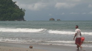 Stock Video Footage of Costa Rican lifeguard patrols beach