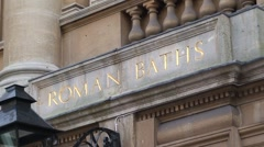 Group Entering Roman Baths Stock Footage