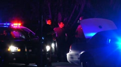 Police cars at traffic stop Stock Footage