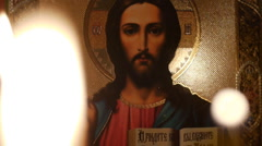 Icon of Jesus Christ.Candles .3a Stock Footage