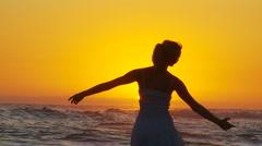 Beach Ballet at sunset - stock footage