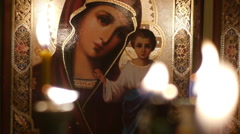 Icon of the Virgin Mary with baby Jesus.Candles .8a Stock Footage