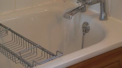Bath Tap Running in Bathroom - stock footage