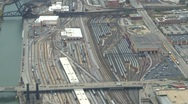 Aerial, Chicago rail yards zoom reveal suburbs Stock Footage