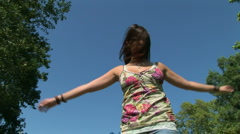 Young woman outdoors twilling around and being carefree Stock Footage