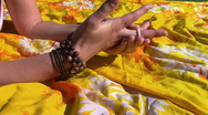 Hands of young woman taking off jewelry Stock Footage