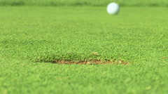 Putting green with golf ball Stock Footage