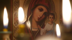 Icon of the Virgin Mary with baby Jesus.Candles .10a - stock footage