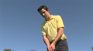 Young man golfing Stock Footage