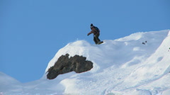Male snowboarder carving through steep terrain Stock Footage