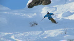 Male skier carving through steep terrain - stock footage