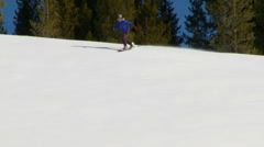 Female snowboarder carving through back-country powder - stock footage
