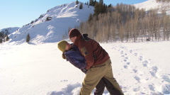 Couple with snow shoes playing in the snow Stock Footage