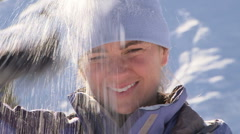 Women smiling and wiping snow off her hat Stock Footage