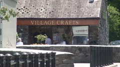 Man Walks Past Craft Shop in Betws-y-Coed Stock Footage