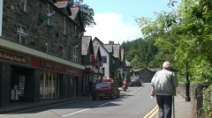 Elderly Man Walking in Betws-y-Coed Stock Footage