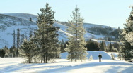 Wide angle of woman running through snow Stock Footage