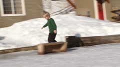 Young boy skates on backyard ice rink Stock Footage
