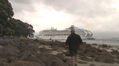 man watchs cruise ship - stock footage