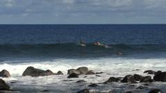 Hawaii surfers waves splash on rocks  Stock Footage