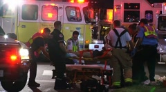 patient being loaded on stretcher  - stock footage