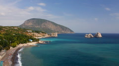Beautiful Crimean landscape with a mountain of Ayu-Dag and rocks Adalars time Stock Footage