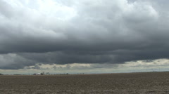 Dark clouds over flat land Stock Footage