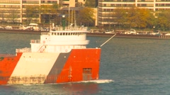 Maritime transportation - Great Lakes cargo ship through frame tight shot Stock Footage