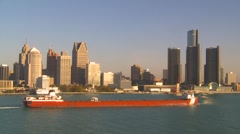 Maritime transportation - Great Lakes cargo ship through frame, Detroit skyline Stock Footage