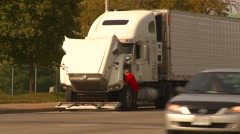 Trucking, broken down transport truck on side of road Stock Footage