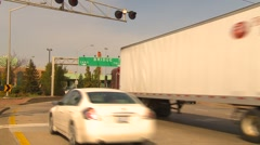 Trucking, many transport trucks entering customs on the way to USA Stock Footage