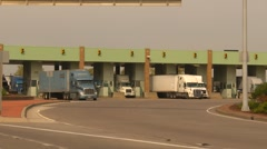 Trucking, many transport trucks leaving customs Stock Footage