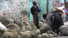Ecuador market & bags of wool - stock footage