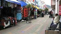 Ecuador Otovalo market with natives Stock Footage