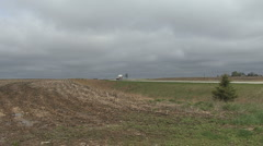 A highway past farmland on the plains Stock Footage