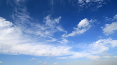 Time lapse, white fluffy clouds over blue sky - stock footage