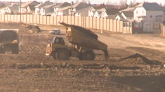 Construction, road building off highway dump truck unload, #3 Stock Footage