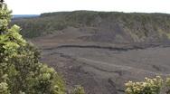 Hawaii Bushes frame Kilauea Iki Crater Stock Footage