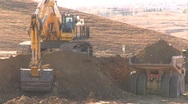 Construction, Cat 773e dump truck, #2 and big backhoe loads Stock Footage