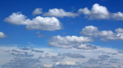 White fluffy clouds over blue sky Stock Footage