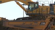 Construction, Cat 773e dump truck, #10 and big backhoe loads tight Stock Footage