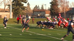 Sports and fitness, High School football, #5 handoff Stock Footage