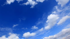 white fluffy clouds over blue sky - stock footage